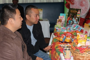 Representatives Ryan and Mark Chong from Encompass Sales look at LASCO Manufacturing products during B2B meetings held in Toronto, Canada to promote Jamaican products.