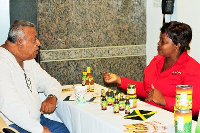 Ms. Denese Palmer, Managing Director, Southside Distributors (right) and Mr. Clarence Bagoo, CariCan International (left) discuss her products at JAMPRO's business forum in Toronto. 6 (six) Jamaican exporters displayed their products at the forum to Canadian distributors to increase their sales in that market.