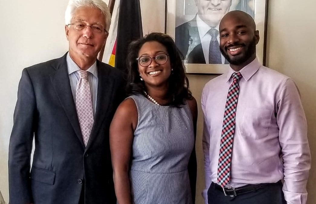 Group picture with three people standing in an office