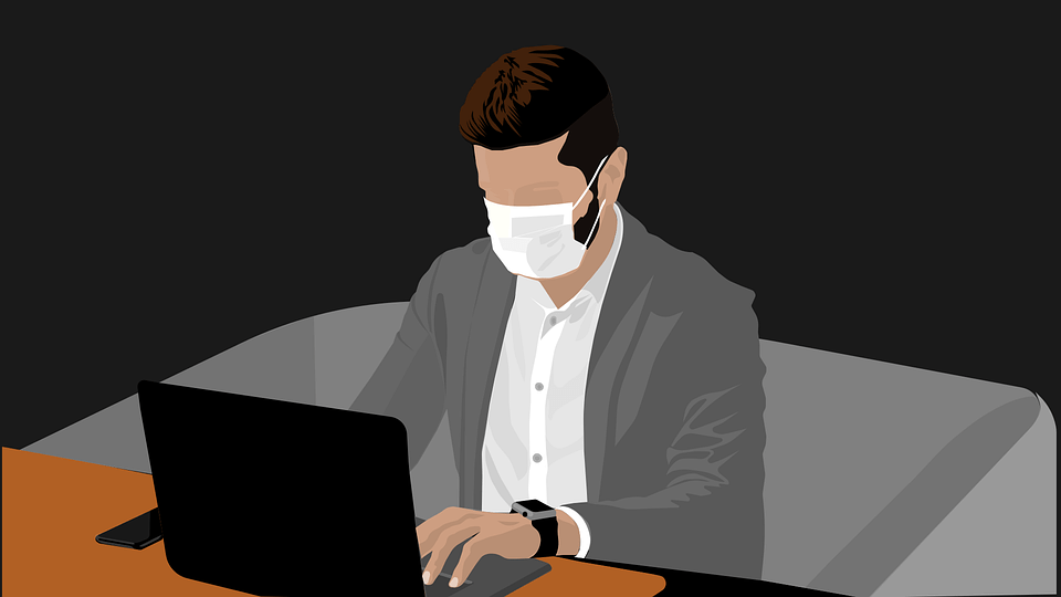 Man at desk wearing a mask